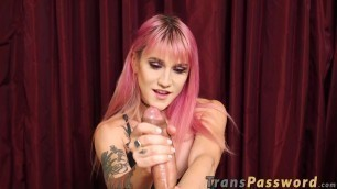 Hot tattooed ts pulling her rock hard shaft with her hands